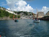 sailing boats going out from Looe